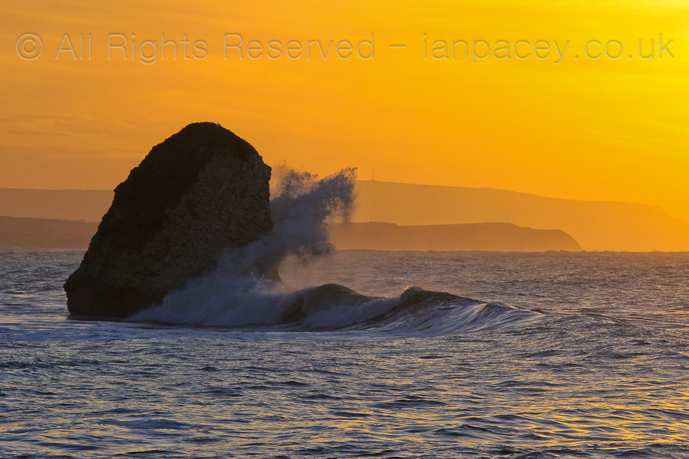 Winter's swell crashing on the Stag rock at sunrise, taken a few moments before I entered the water for a quick surf before work.
